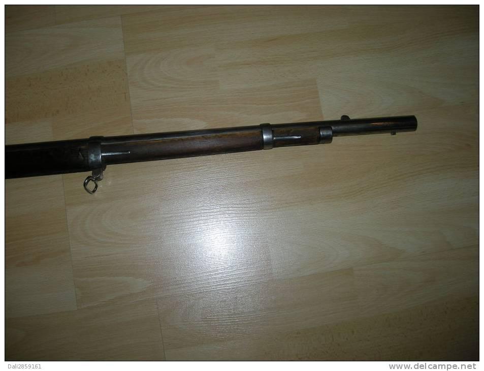 un fusil à silex  ok  mais qui vient d'ou ? Fusil_11
