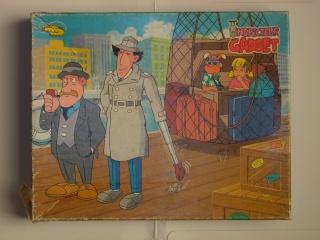 Les puzzles 80's de D.A, séries ou de  gamme de jouets.... Inspec11