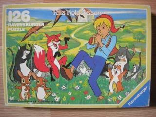 Les puzzles 80's de D.A, séries ou de  gamme de jouets.... Nils10