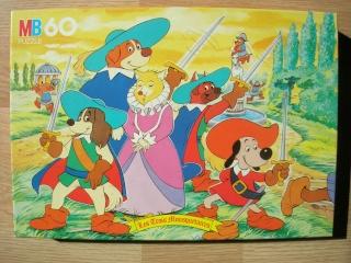 Les puzzles 80's de D.A, séries ou de  gamme de jouets.... Trois_10