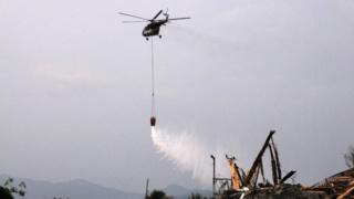 Indonesië sproeit ontsmettingsmiddel op door tsunami getroffen wijken 167