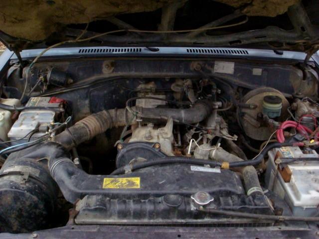 [Question] Protection entre passage de roue Av et moteur, durite..etc Dsc04810