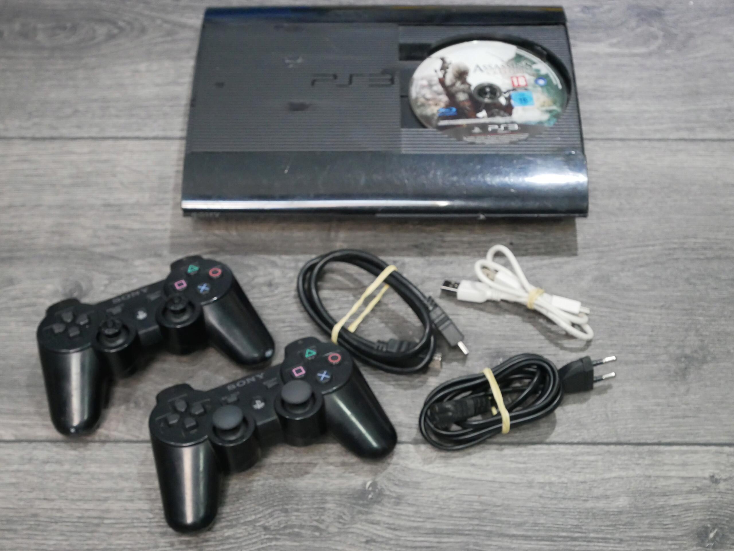 [EST] Lot PS3 Ultra-Slim 500G0 + 18 jeux + volant P1070231