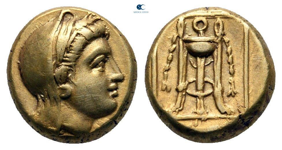 Aide à l'identification d'une monnaie montée sur épingle.  377-3210