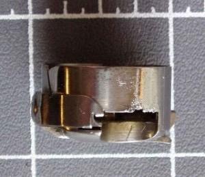Aiguilles qui tapent le dessus de la boite a cannette: la cause 235c7210