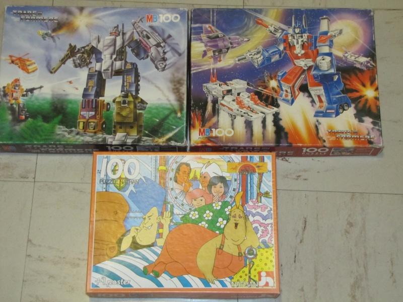 Les puzzles 80's de D.A, séries ou de  gamme de jouets.... Img_2610
