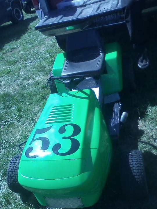my lime green raceing lawn mowers  39244110