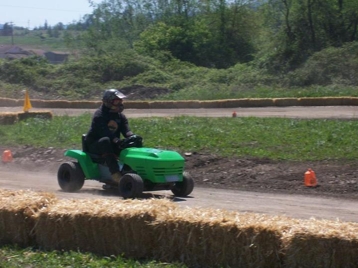 my lime green raceing lawn mowers  40355810