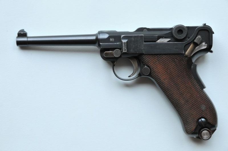 Les pistolets Parabellum suisses, modèles DWM 1906. Dwm_1911