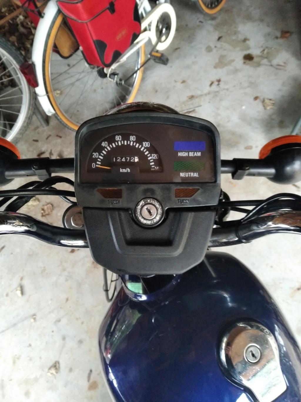 Souci concernant ma Yamaha SR 125  Img_2010