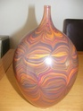 any ideas please large multi colour american vase Potter10