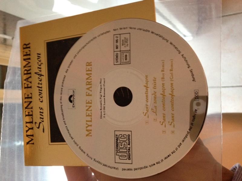 CD maxi promo OR sans contrefacon ECRITURES JAUNES Photo12
