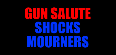 GUN SALUTE SHOCKS MOURNERS - Cops, residents take cover at service  Main14