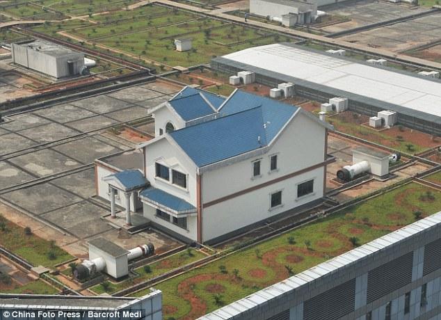 Maisons sur le toit d'un centre commercial, Xian de Zhuzhou - Chine Mai210
