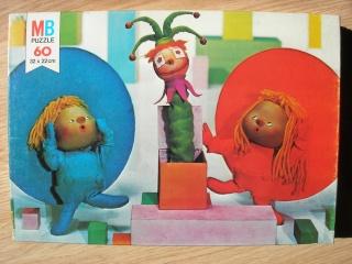 Les puzzles 80's de D.A, séries ou de  gamme de jouets.... Chapi_10