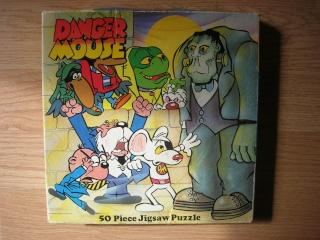 Les puzzles 80's de D.A, séries ou de  gamme de jouets.... Dm10