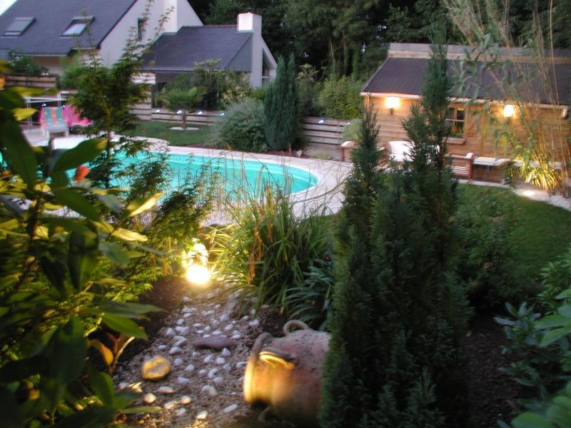 Evolution du jardin quelques années après la construction de la piscine - Page 3 0610
