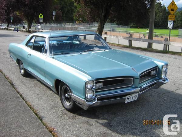 Identifiez le plus de (vieilles) voitures. 1966-g10
