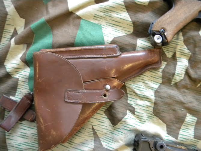 Réflexions sur la production de pistolets Luger P 08, par Mauser, en 1945-1946. - Page 3 Holste10