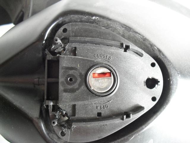 Remplacer un bouchon de réservoir sans sa clé. Cimg1413