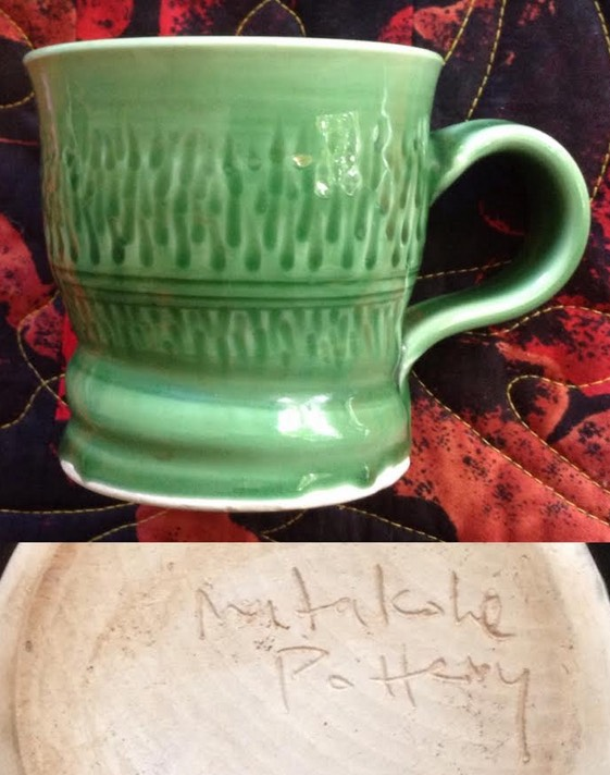 "a mug with Dave Wolland's ""Matakohe Pottery"" mark Matako10"