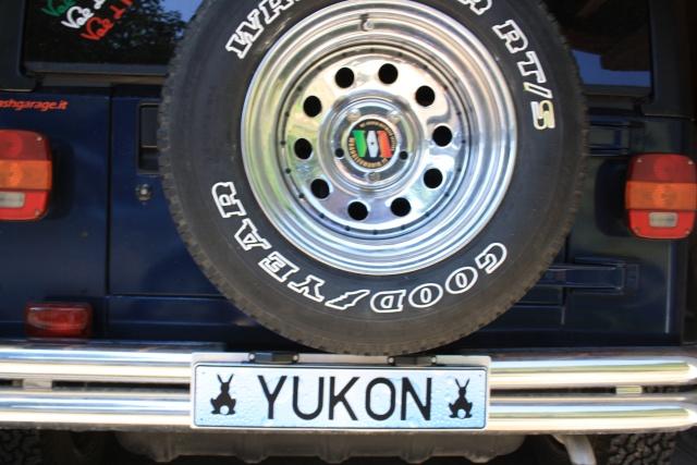 Cerco porta targa per ruota di scorta Tj 00112