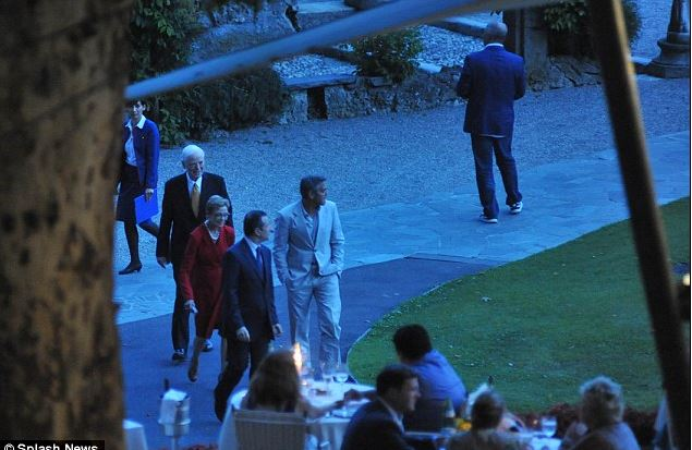 George Clooney looks suave in white suit in Lake Como with his parents on 23 July Cloone15
