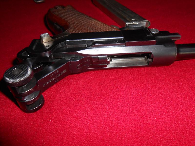 Les Luger suisses, modèles 1906 produits par la Waffen Fabrick à Berne. - Page 2 025_0110