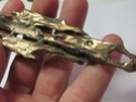 Strange metal piece  08710