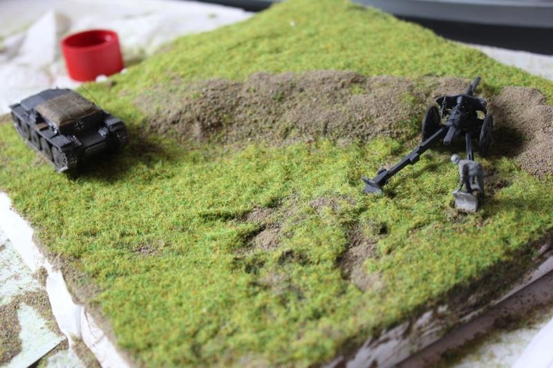 Diorama d'un leFH 18 en batterie au 1/72 Thumb270