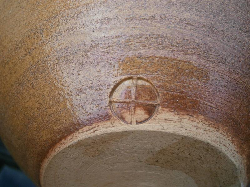 Dark amber textured bowl cross mark  P8201023