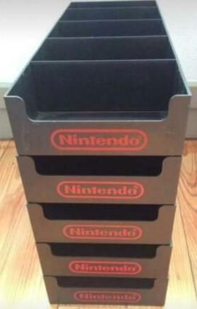 casiers de présentation en lieu de vente pour jeux Game Boy ??? Nes_st10