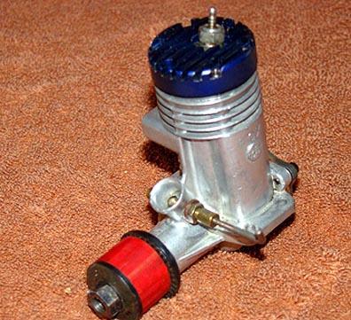 Why the slanted glow plug on some Fox engines? Lj35_210