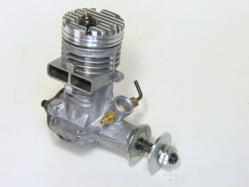 Why the slanted glow plug on some Fox engines? Lj_110