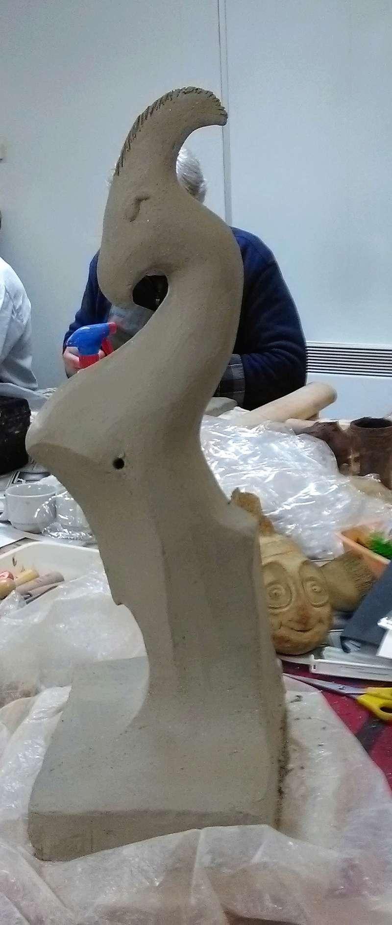 demande d'aide pour sculpture ailée Img_2011