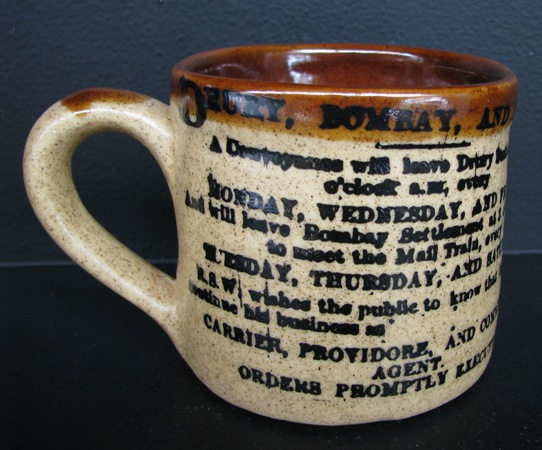 Orzel Drury mug with newspaper print on it Drury_10