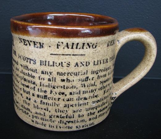 Orzel Drury mug with newspaper print on it Drury_11