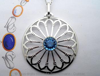 Rosace argent et topaze bleue facettée sertie or Peaf9013