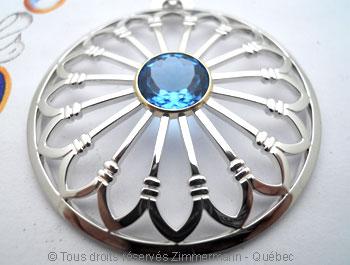 Rosace argent et topaze bleue facettée sertie or Peaf9014
