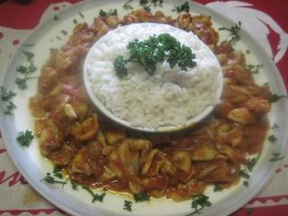 Blancs de calamar à la sauce tomates et curry. 10959610