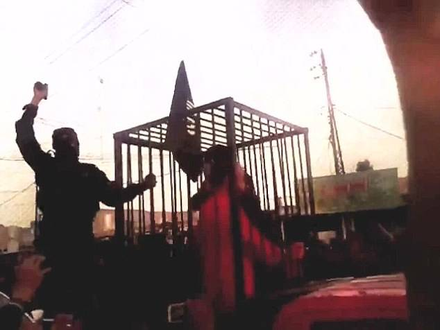 Welcome to Hell:ISIS hang bodies at town entrance Hell_110