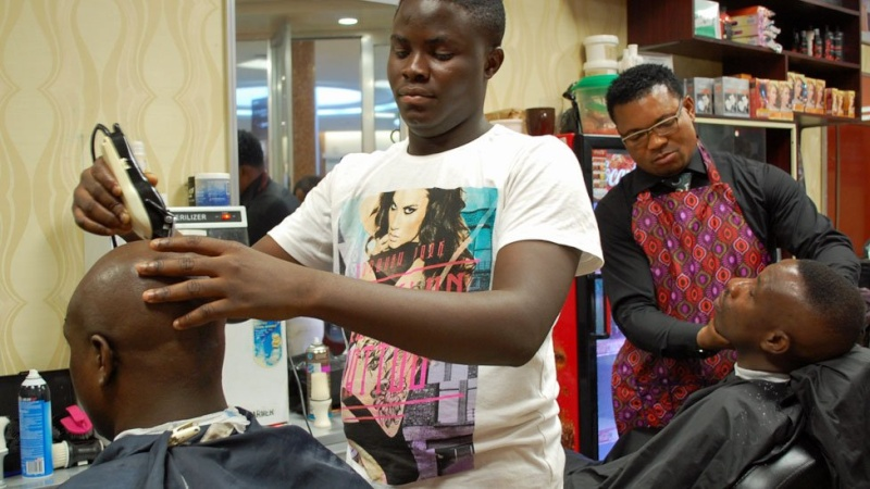 In pictures: Nigerian banker turned hairstylist spins money N710