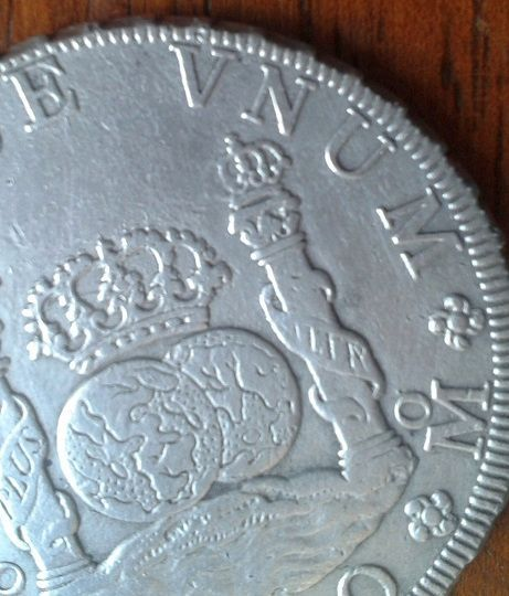 agains about 8 reales Dos Mundos 1770 , genuine or fake ? 510