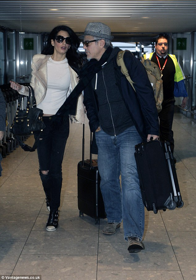 George and Amal Clooney spotted at LAX Image14