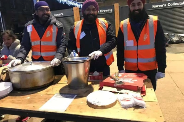 Sikh Seva Society UK and supporters give hot food and gifts to homeless in the city A0157610