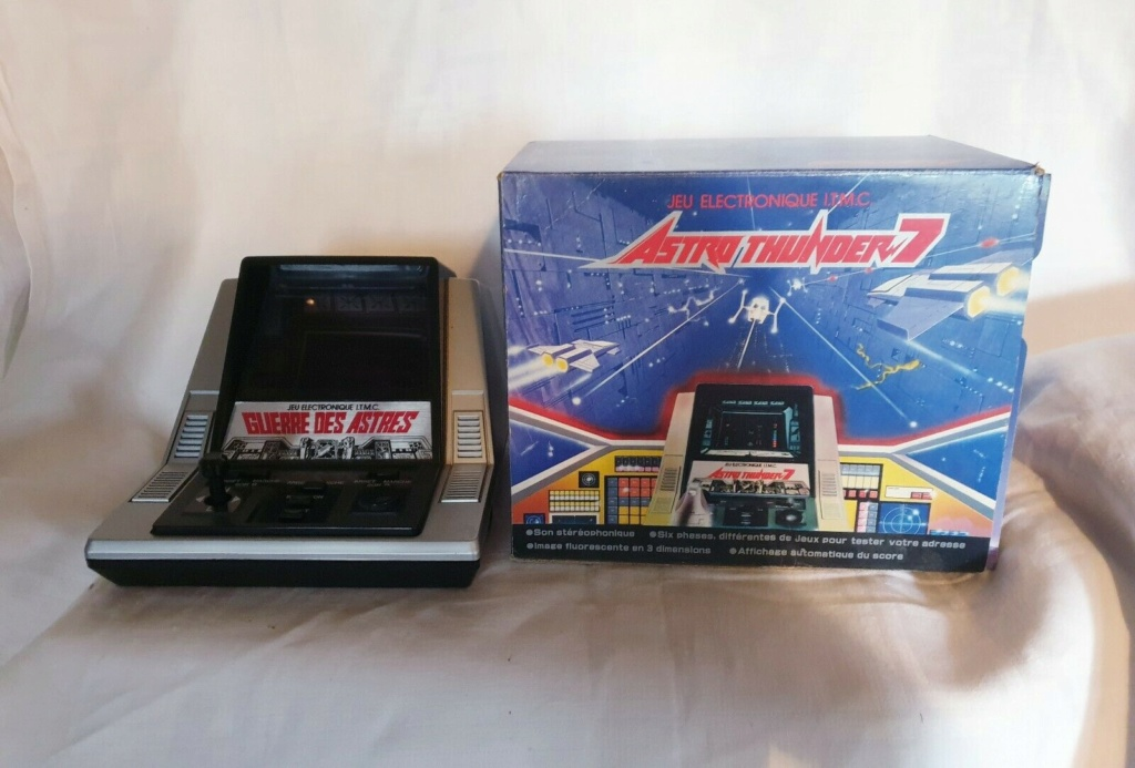 [Besoin d'infos] Tabletop Astro Thunder 7 S-l16011
