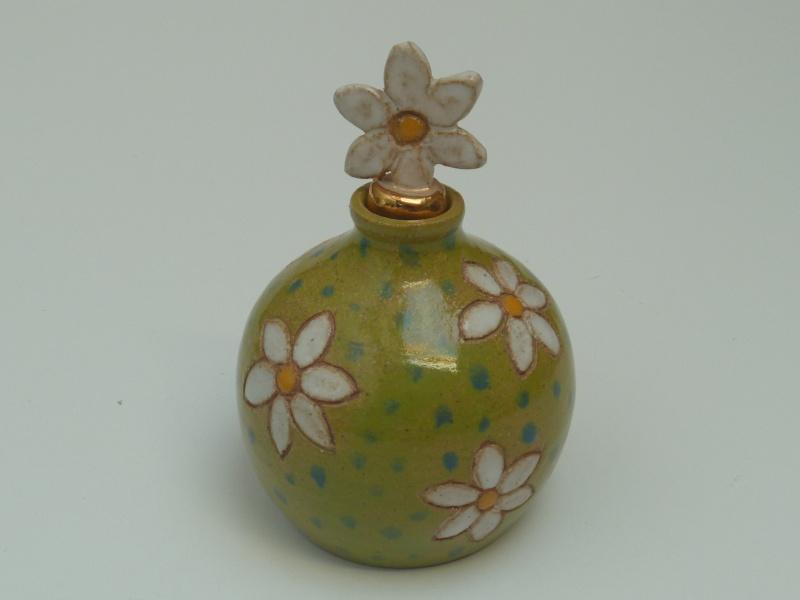 Daisy perfume bottle marked RC P1010539