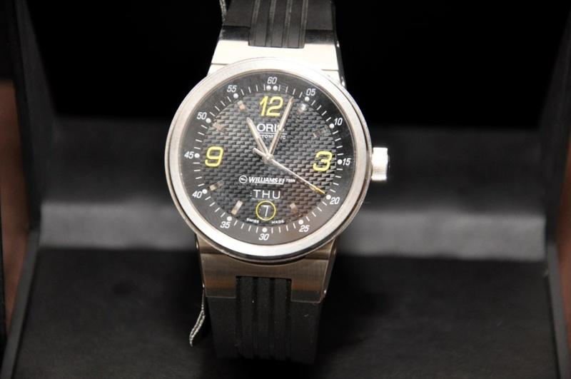 J'hésite entre trois montre (oris, breitling,tag heuer) E_4ic710