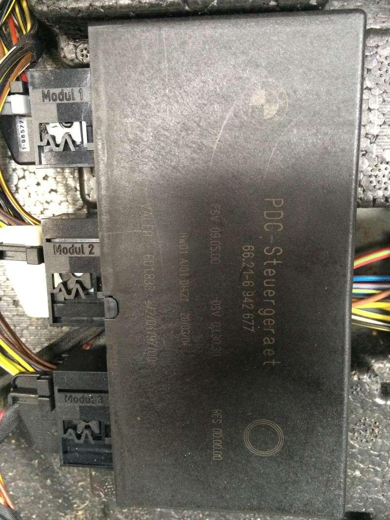 (bmw 530d e60) a quoi sert ses 3 boitiers dans le coffre ? Img_1012