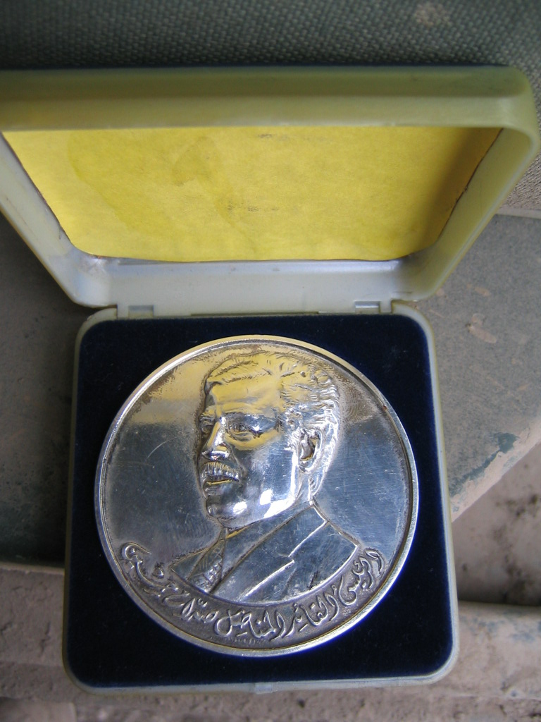 Can someone help identify unknown Saddam coin! Img_0811